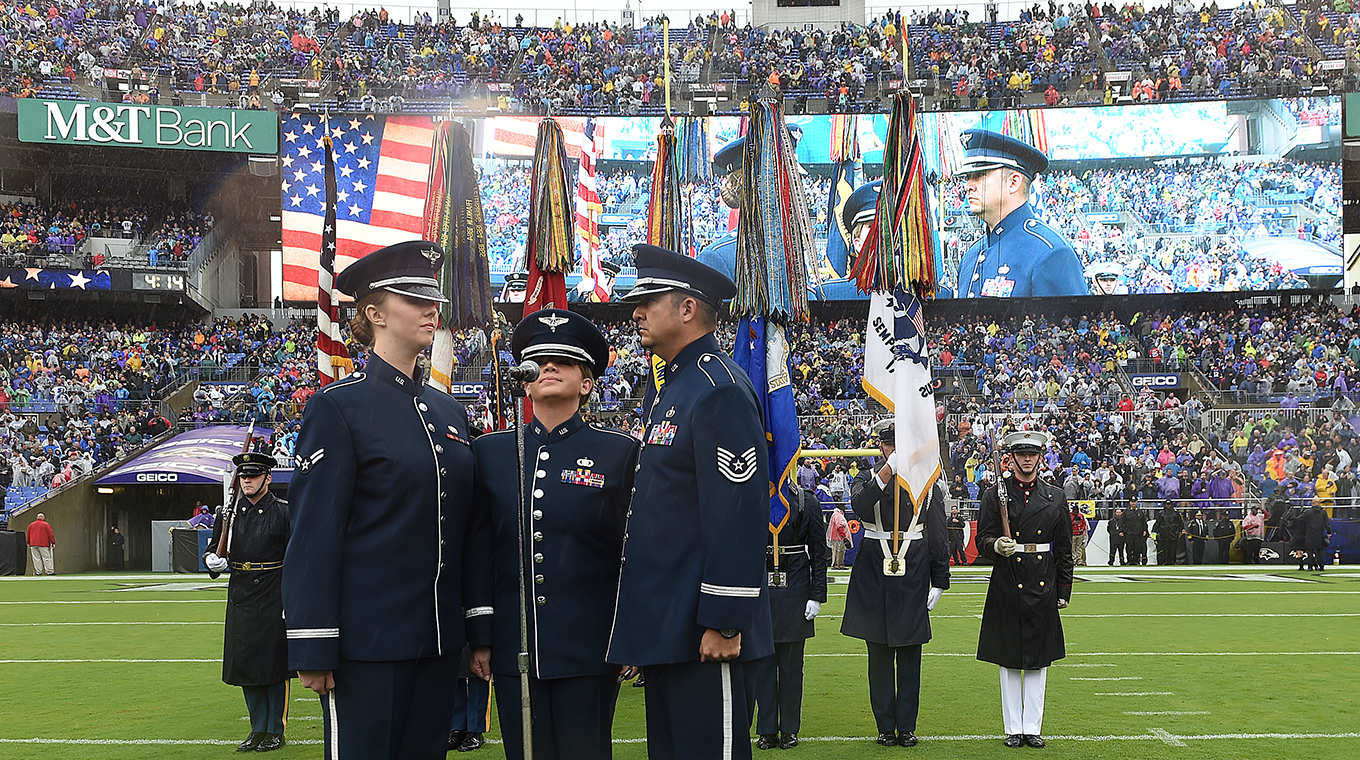 Technical Sergeant Justin Allen, Staff Sergeant Melissa Lackore, and Airman First Class Rachael Colman of the USAF Heritage of America Band sing