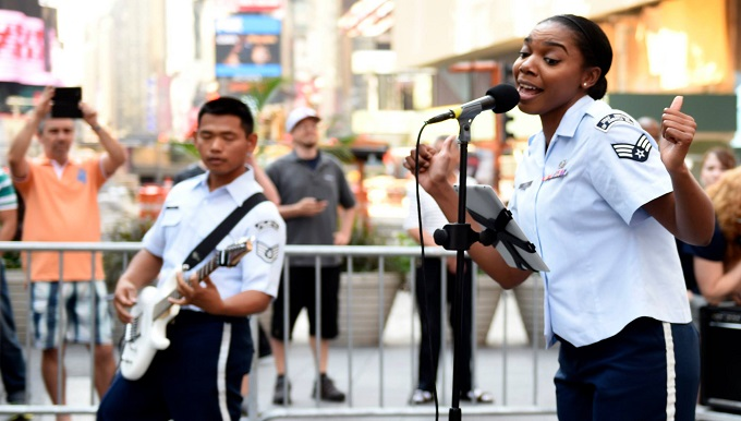 Staff Sergeant Daniel Santos, guitar and Senior Airman Ashley Cook perform in New York's Times Square, as part of the 2015 Air Force Birthday Celebration.